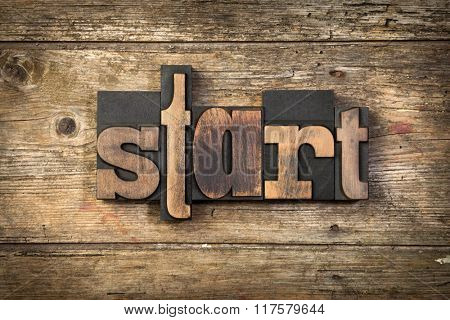 word START, set with letterpress type on rustic wooden background
