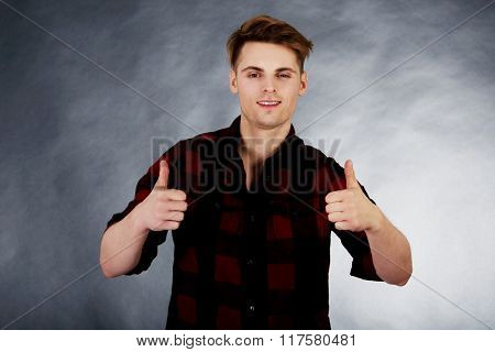 Cheerful man with thumbs up.