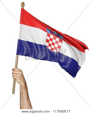 Hand proudly waving the national flag of Croatia