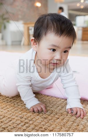 Cute baby on the carpet at home