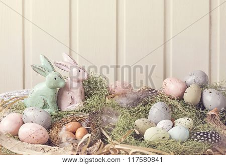 Easter pastel colored decoration on grass