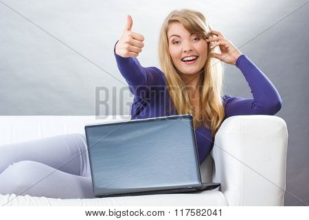 Happy Woman With Laptop Sitting On Sofa And Showing Thumbs Up, Modern Technology