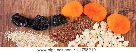 Portion Of Linseed, Rye Flakes, Oat Bran And Dried Fruits, Concept Of Healthy Nutrition And Increase