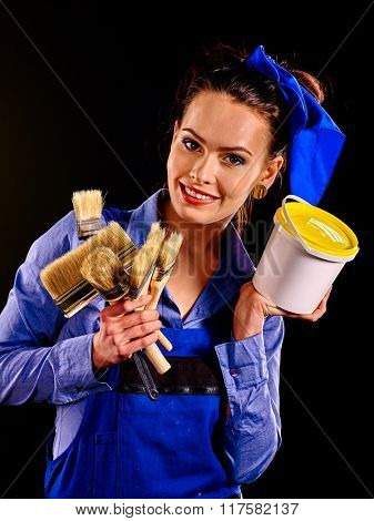 Builder woman with  tin of paint and brushes.