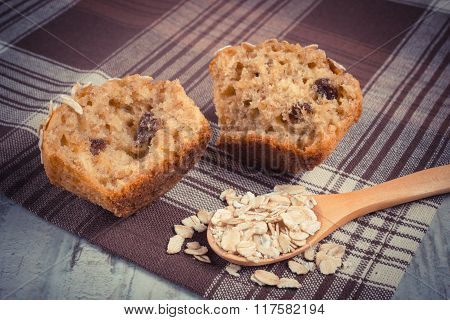 Vintage Photo, Fresh Muffin With Oatmeal Baked With Wholemeal Flour On Checkered Tablecloth, Delicio