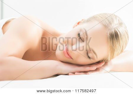 Beautiful girl sleeping and have a spa treatment isolated on white.