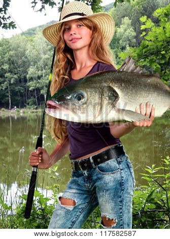 Girl fishing early morning with lot of big fishes in hands posing at camera.