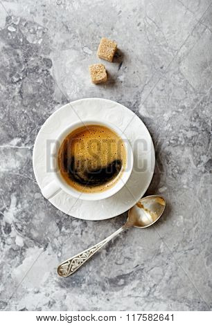 Cup of coffee on a stone background
