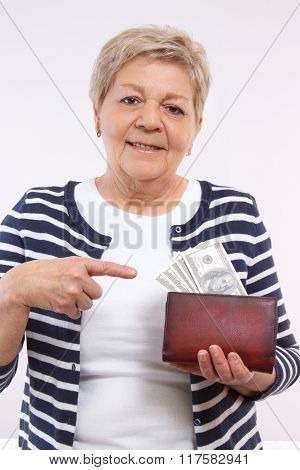 Happy Senior Female Showing Dollar Currencies In Wallet, Concept Of Financial Security In Old Age