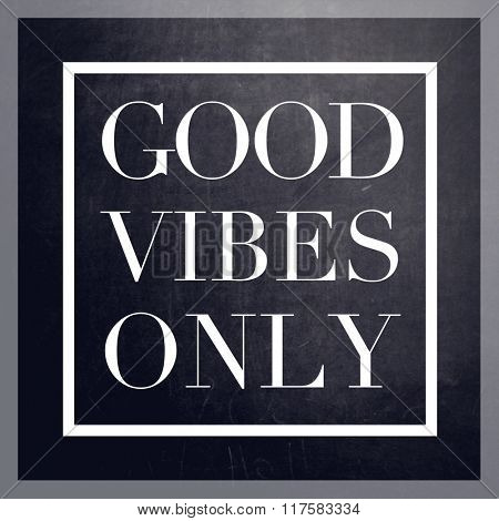 Inspirational Typographic Quote on black chalk board - Good vibes only