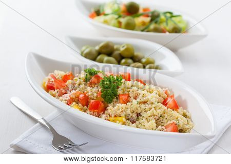 Couscous salad with tomato, pepper with olives