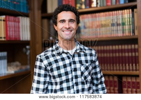 Smiling man in a library