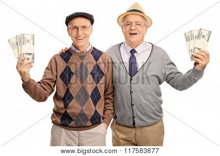 Tow senior gentlemen holding several stacks of money and posing together isolated on white background