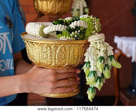 people holding the wreath of flower on the pedestal.use for offer honarable people in thai culture