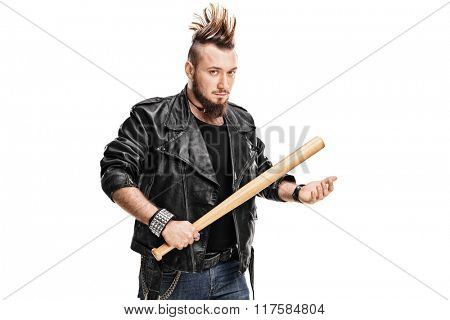 Young violent punk rocker holding a baseball bat and looking at the camera isolated on white background