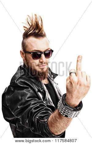 Vertical shot of a young punk rocker showing his middle finger towards the camera isolated on white background