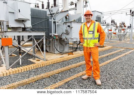 male electrical engineer standing in substation