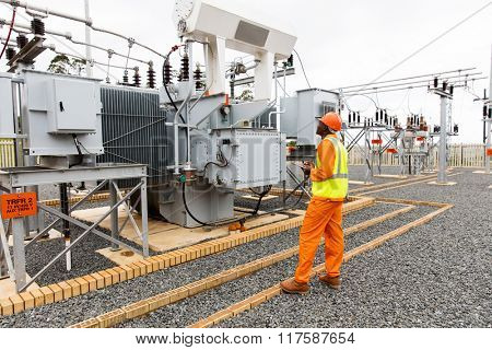 professional african electrician working in electrical substation