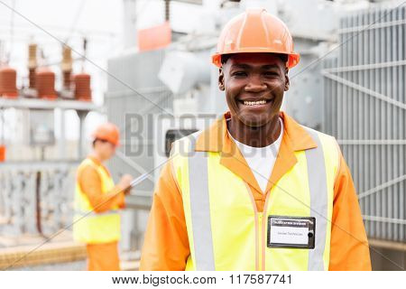 happy senior african american technical worker in substation