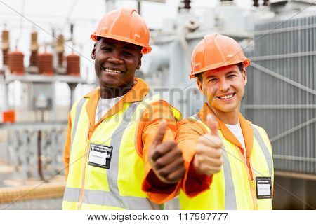 handsome electricians giving thumb up in substation