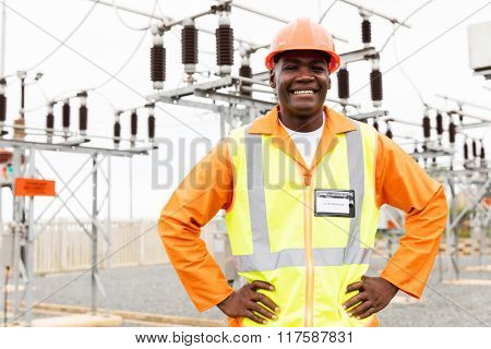 cheerful senior technician looking at the camera in substation