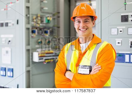 happy electrical engineer standing in control room