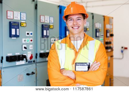 handsome industrial technician in front of control panel