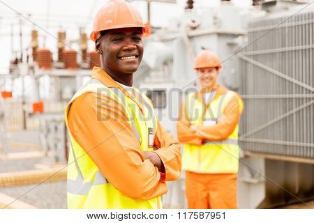 african american power company worker in substation
