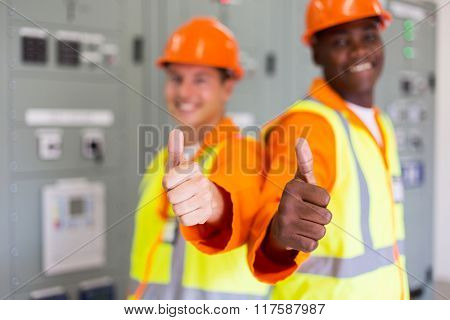 happy multiracial electrical co-workers thumbs up