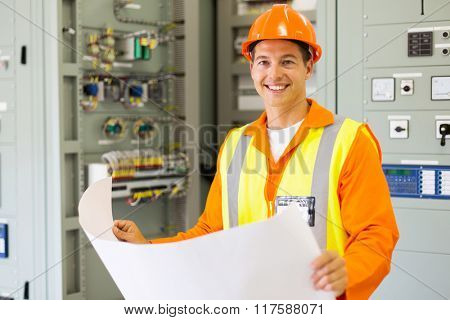 portrait of young control room engineer holding blueprint