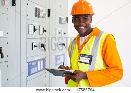 portrait of senior african technician working in control room