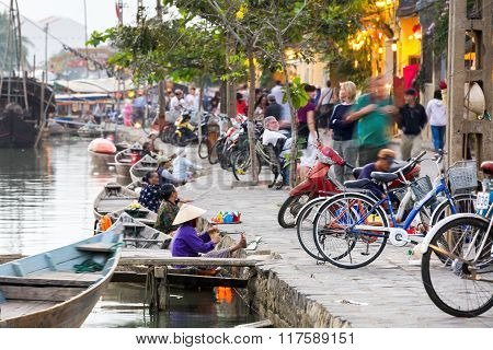 Old women are selling colourful lanters from the boats on the street of Hoi An Ancient Town