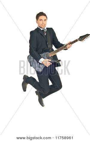 Business Man Jumping With Guitar