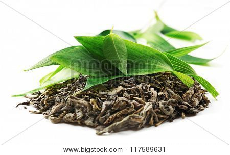 Pile of dry tea with green leaves, isolated on white