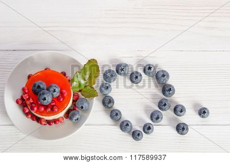 Frame- Heart From Blueberry  And Fruitcake On Wooden Table   Top View/ Empty Space For Text