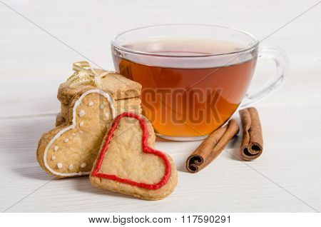 Cookies-hearts Related Together And A Cup Of Tea On  Wooden Table