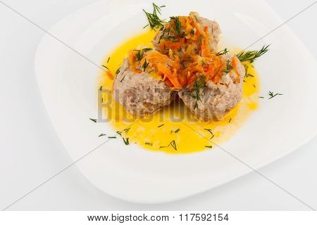 Three Meatballs On A White Plate