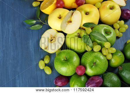 Fruits on dark blue wooden background