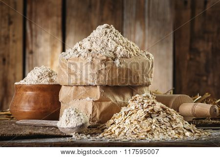 Wholemeal Oat Flour And Oat Flakes, Rolling Pin, Spoon