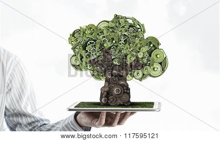 Man presenting green concept on tablet