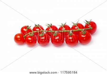 tomatoes with green leaves isolated on white background