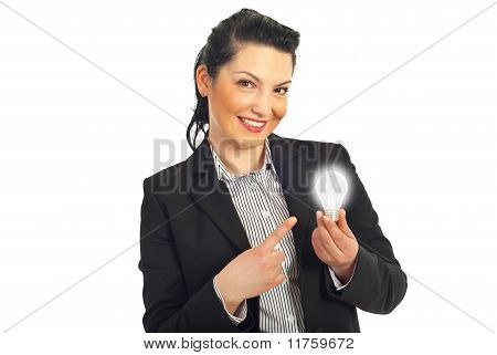 Business Woman Pointing To Light Bulb