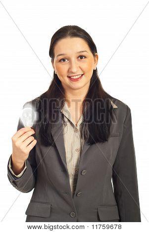Executive Female Holding Light Bulb