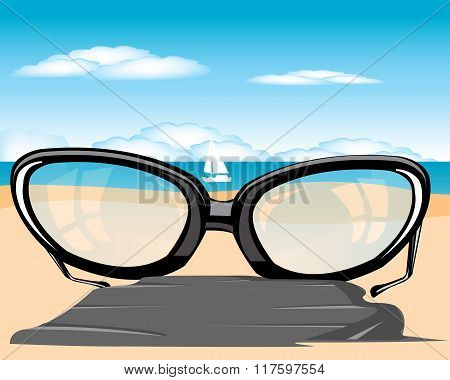 Spectacles on beach