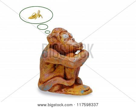Sad Monkey From Clay Pottery  Dreams About A Banana. Isolated On White