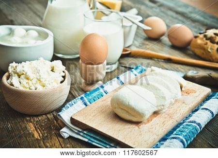 milk products on old wooden table. top view