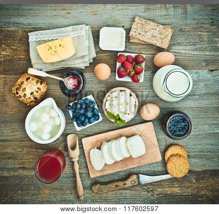 Summer breakfast. fruit and dairy products on a wooden table. top view
