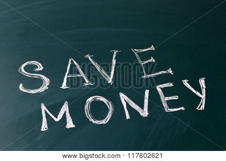 Save money concept on a blackboard background