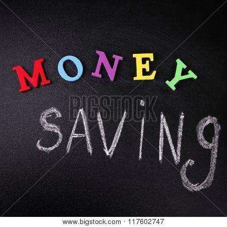 Money saving concept on a blackboard background