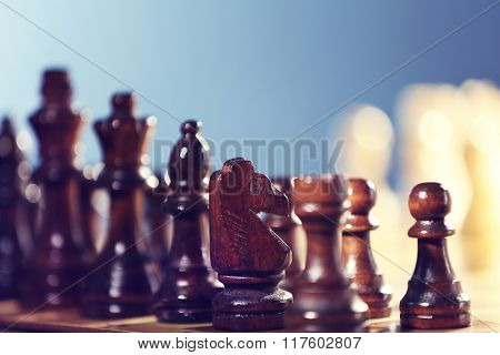Chess pieces on blue background